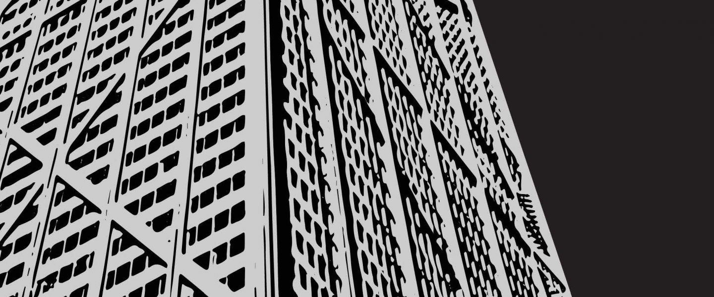 black and white close up of a skyscraper from the perspective of the ground