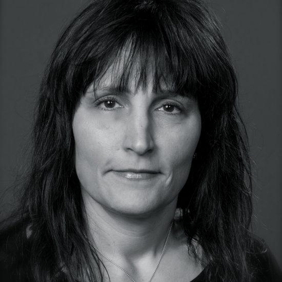 woman with dark hair facing the camera