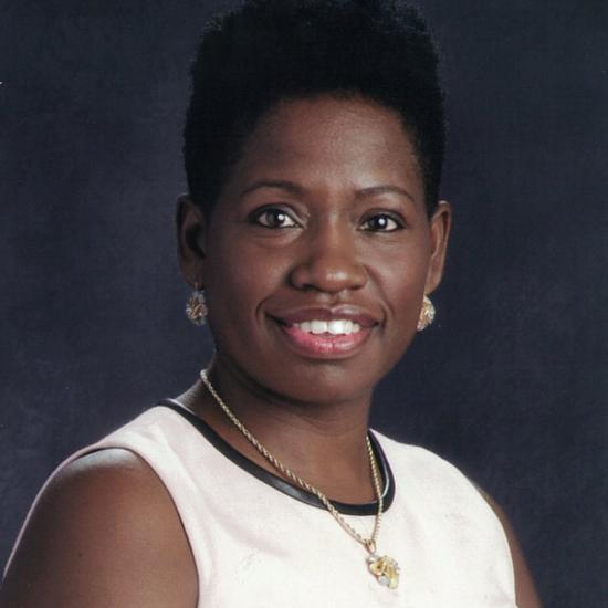 a woman smiles toward the camera
