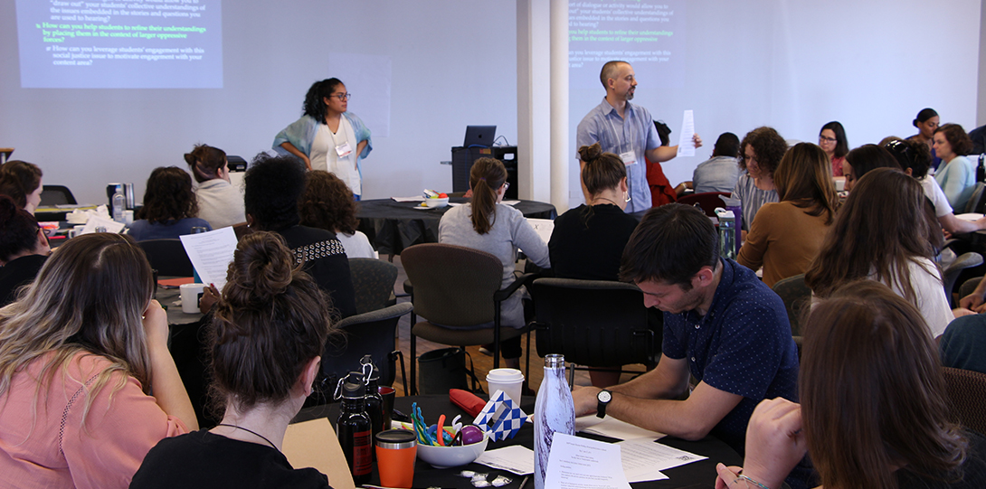 Photo of Alejandra Frausto and Danny Morales-Doyle presenting at the 2019 Summer Education Workshop