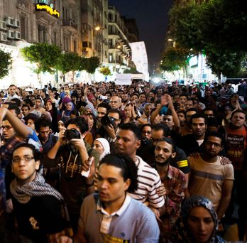 crowd of protesters in a street in Egypt